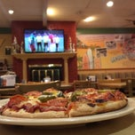 Photo taken at Straw Hat Pizza by Manny G. on 6/18/2014