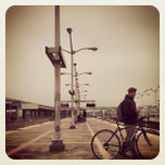 Photo taken at Emery Go-Round MacArthur BART Bus Stop by Rig G. on 10/23/2013
