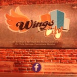 Photo taken at Wings City by Claudia T. on 3/30/2013