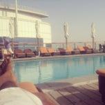 Photo taken at Hilton Dubai Roof Pool by Prashanth K. on 8/31/2013