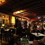 Photo taken at Surf's Pizzaria & Restaurante by Wilson S. on 6/15/2013