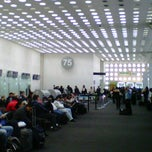 Photo taken at Sala/Gate 75 by Julio G. on 2/2/2012
