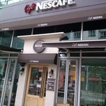 Photo taken at Café NESCAFÉ® by Kyutae T. on 6/14/2013