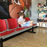Photo taken at Sport Clips by david b. on 7/27/2013