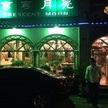 Photo taken at 弯弯月亮 Crescent Moon Uighur Muslim Restaurant by Hasan Ş. on 5/30/2014