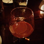 Photo taken at Swizz Restaurant & Wine Bar by Melody K. on 2/24/2013
