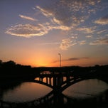 Photo taken at Pfluger Pedestrian Bridge by Aaron U. on 6/16/2013