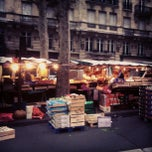 Photo taken at Marché de Raspail by Eakin R. on 3/2/2012