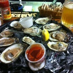 Photo taken at Dockside Seafood & Oyster Bar by Ken S. on 9/27/2013