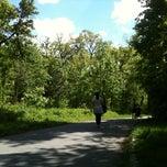 Photo taken at Bois de Boulogne by Melanie M. on 5/1/2012