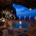 Photo taken at Grotta Palazzese by Diego L. on 8/26/2012