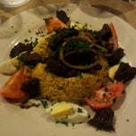 Photo taken at El Patio Argentine Café by Nicolas on 6/15/2012