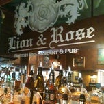 Photo taken at The Lion & Rose British Restaurant & Pub by Katie T. on 6/15/2011
