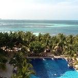 Photo taken at Oasis Palm Beach Resort by Débora M. on 3/31/2012