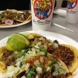 Photo taken at Tacos El Gavilan by Jenn E. on 2/12/2012