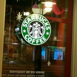 Photo taken at Starbucks by Melanie J. on 12/15/2011