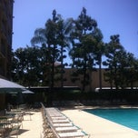 Photo taken at Pool at  Hotel Anaheim Resort by Sherm N. on 4/21/2012
