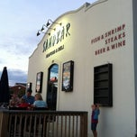 Photo taken at Sandbar Seafood, Deli, And Oyster Bar by Peggy M. on 7/18/2011