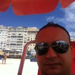 Photo taken at Barraca do Ray 149 - Copacabana by Anhicolas O. on 1/13/2012