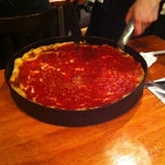 Photo taken at Uno Pizzeria & Grill - Chicago by Alex C. on 6/13/2012