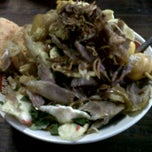 Photo taken at Bubur ayam Jl. Kwini (depan atrium senen) by Christ I. on 6/12/2012