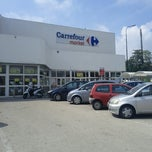 Photo taken at Carrefour Market by Renato on 9/12/2012