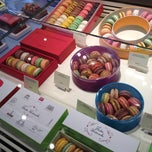 Photo taken at Pierre Hermé by Dorothy M. on 3/15/2012