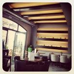 Photo taken at Corso Como Cafe by Chris D. on 3/5/2012