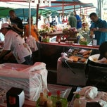 Photo taken at Feira Livre by Jonathan K. on 7/25/2012