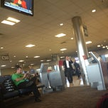 Photo taken at Gate C48 by Chris S. on 4/11/2012