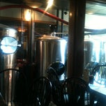 Photo taken at Hops Restaurant Bar & Brewery by Kyle M. on 8/4/2012