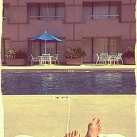 Photo taken at Hilton Rooftop Pool by Meg H. on 6/24/2012