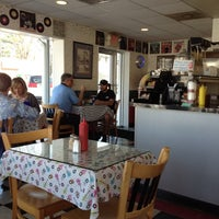 Photo taken at Devage's Subs & Donuts by Henry H. on 3/14/2012