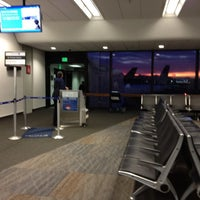 Photo taken at Gate 75 by Jodie R. on 6/17/2012