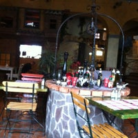 Photo taken at Pizzeria in špageterija Piazza by Lana on 4/8/2012