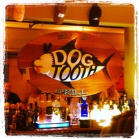 Photo taken at Dogtooth Bar & Grill by Kevin K. on 8/26/2012