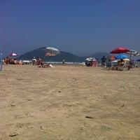 Photo taken at Praia do Sesc Bertioga by Marina Q. on 9/8/2012