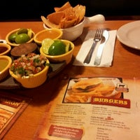 Photo taken at El Papalote Taco & Grill by Sergio L. on 12/17/2011