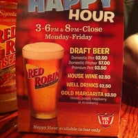 Photo taken at Red Robin Gourmet Burgers by Taylor M. on 4/22/2011
