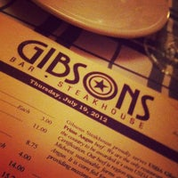 Photo taken at Gibsons Bar & Steakhouse by Cuit G. on 7/20/2012