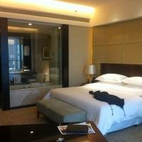 Photo taken at Sheraton Guangzhou Hotel 广州喜来登酒店 by Anita C. on 3/1/2012