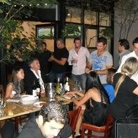 Photo taken at Garlic New York Pizza Bar by estherinc on 11/23/2011