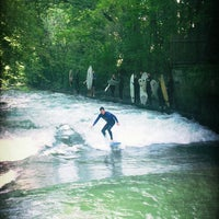 Photo taken at Eisbach Wave by Silviu B. on 9/7/2013
