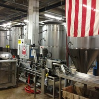 Photo taken at DC Brau Brewing Co by Tom M. on 8/11/2013