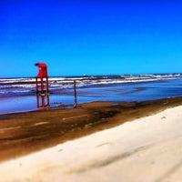 Photo taken at Praia de Imbé by Elisa C. on 9/23/2012