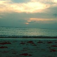 Photo taken at Layang-layangan Beach by Fansuri I. on 6/16/2013