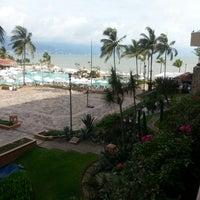 Photo taken at CasaMagna Marriott Puerto Vallarta Resort & Spa by Roberto T. on 7/19/2013