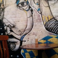 Photo taken at Sappho Books, Cafe & Wine Bar by Marta P. on 6/25/2015