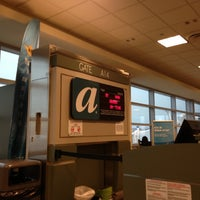 Photo taken at Concourse A by Joey M. on 12/9/2012