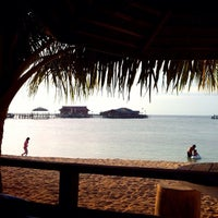 Photo taken at Derawan Beach Cafe & Cottage by Ery H. on 3/16/2014
